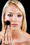 Applying makeup Stock Photography