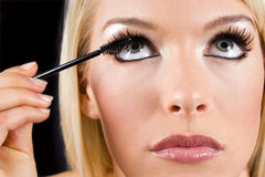 Applying makeup Royalty Free Stock Photography