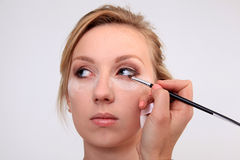 Applying makeup Royalty Free Stock Photos