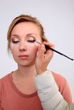 Applying makeup Stock Image