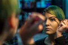 Applying Makeup stock image