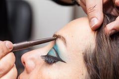 Applying makeup on eyebrows Stock Photo