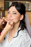 Applying makeup to the bride Royalty Free Stock Image