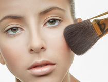 Applying makeup to the face Royalty Free Stock Photography