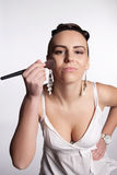 Applying makeup to the face Royalty Free Stock Photo