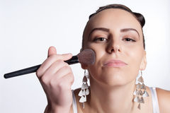 Applying makeup to the face Stock Photography