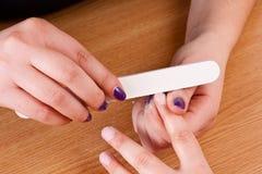 Applying manicure Royalty Free Stock Photo