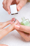 Applying manicure Royalty Free Stock Image