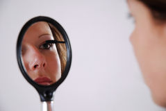 Applying mascara Stock Image