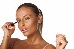 Applying mascara Stock Photography