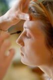 Applying mascara. Makeup artist applying mascara Royalty Free Stock Photography