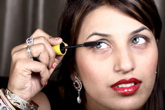 Applying mascara. Closeup shot of female model applying mascara royalty free stock image