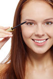 Applying mascara Stock Photos