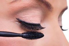 Applying mascara Royalty Free Stock Photos