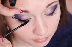 Applying mascara on the lashes model Royalty Free Stock Photo
