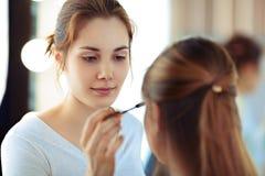 Applying mascara Stock Photos