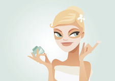 Applying mask. Cute young woman applying facial mask Royalty Free Stock Photo