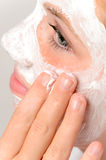 Applying mask fingers young girl beauty skin Stock Photos