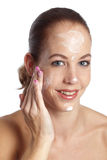 Applying moisturizer Stock Images