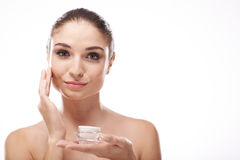 Applying moisturizer Royalty Free Stock Photo