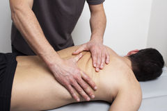Applying myofascial therapy on patients back Royalty Free Stock Photo
