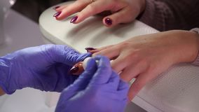 Applying nail oil manicure stock footage