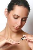 Applying nail polish Stock Image
