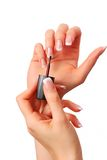 Applying nail polish Royalty Free Stock Image