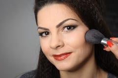 Applying perfect makeup Stock Photography