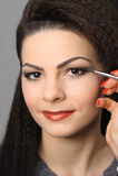 Applying perfect makeup Royalty Free Stock Photos