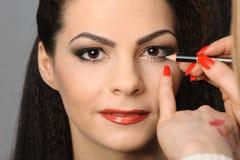 Applying perfect makeup Stock Photos