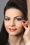 Applying perfect makeup Royalty Free Stock Image