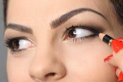 Applying perfect makeup Stock Images
