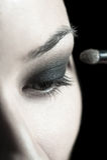 Applying perfect makeup Stock Photo