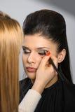 Applying perfect makeup Royalty Free Stock Photo