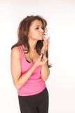 Applying pink lipgloss Royalty Free Stock Photo