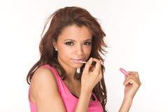 Applying pink lipgloss Stock Images