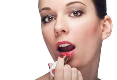 Applying with pink lipstick Royalty Free Stock Photo