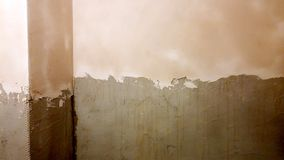 Applying plaster on the walls. With fiberglass layer and smoothing walls stock images