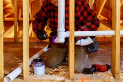 Free Applying Plumber Pipe Drain And Vent Plumbing System At New Home Construction Royalty Free Stock Photos - 144407888