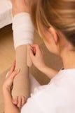 Applying a pressure bandage Stock Photo