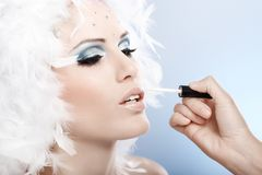 Applying professional winter makeup Royalty Free Stock Photo
