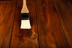 Applying protective varnish on a wooden table Stock Photography