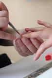 Applying red nail polish Royalty Free Stock Image