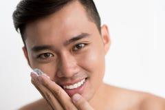 Applying shaving cream Stock Photo