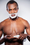 Applying a shaving cream. Royalty Free Stock Photography