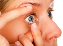 Applying Soft Contact Lenses stock images