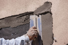 Applying stucco Royalty Free Stock Photos