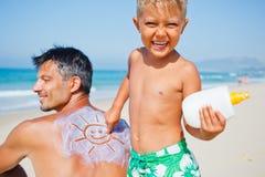 Applying Sun Cream Stock Images