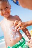 Applying sun cream Stock Image